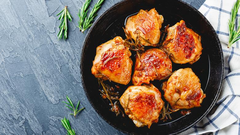 crispy chicken thighs in pan