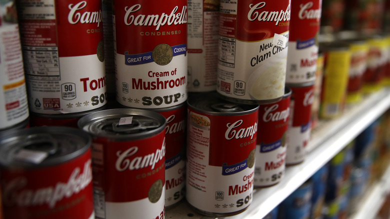 Line of Campbell's soup cans in store