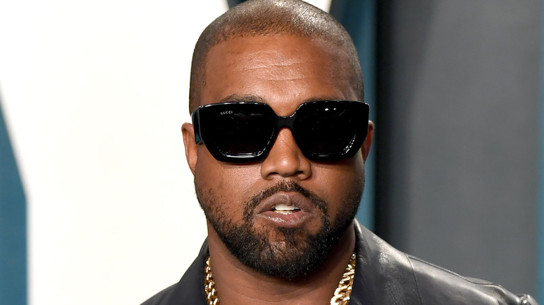 Kanye West with sunglasses and gold chain
