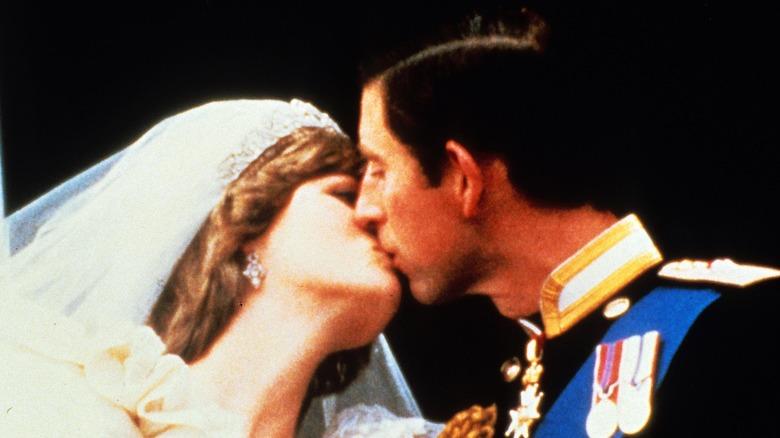 Prince Charles and Princess Diana kiss at their wedding