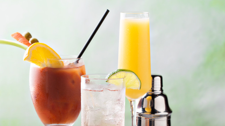 Bloody mary and mimosa cocktail with shaker