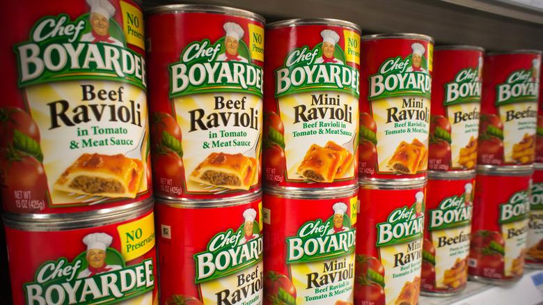 Cans of Chef Boyardee on a shelf