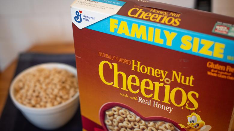 Box of Honey Nut Cheerios next to bowl
