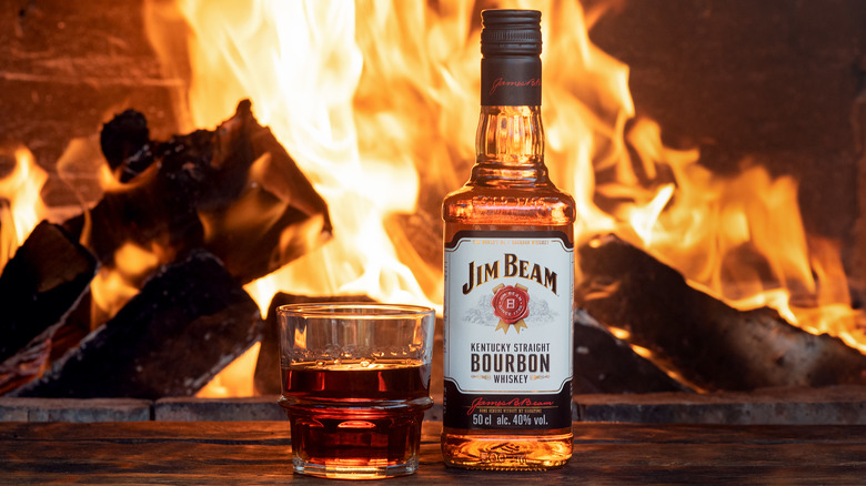 Bottle of Jim Beam by a fireplace