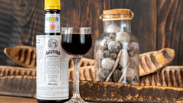 Angostura bitters in bottle and glass