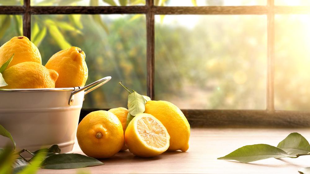 Basket of lemons on sunny table