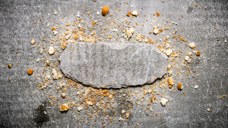 Crumbs on gray stone