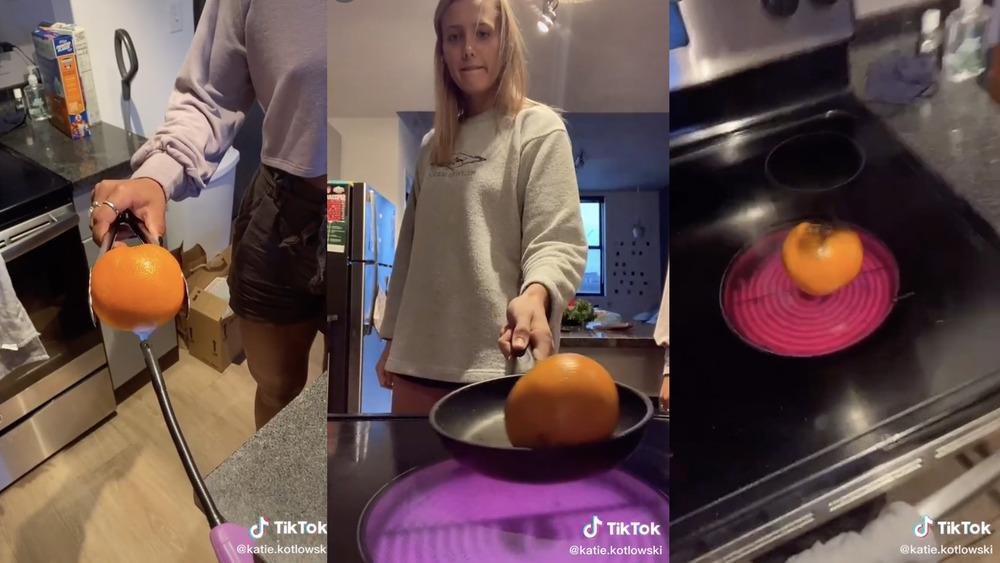 Katie Kotlowski burning an orange