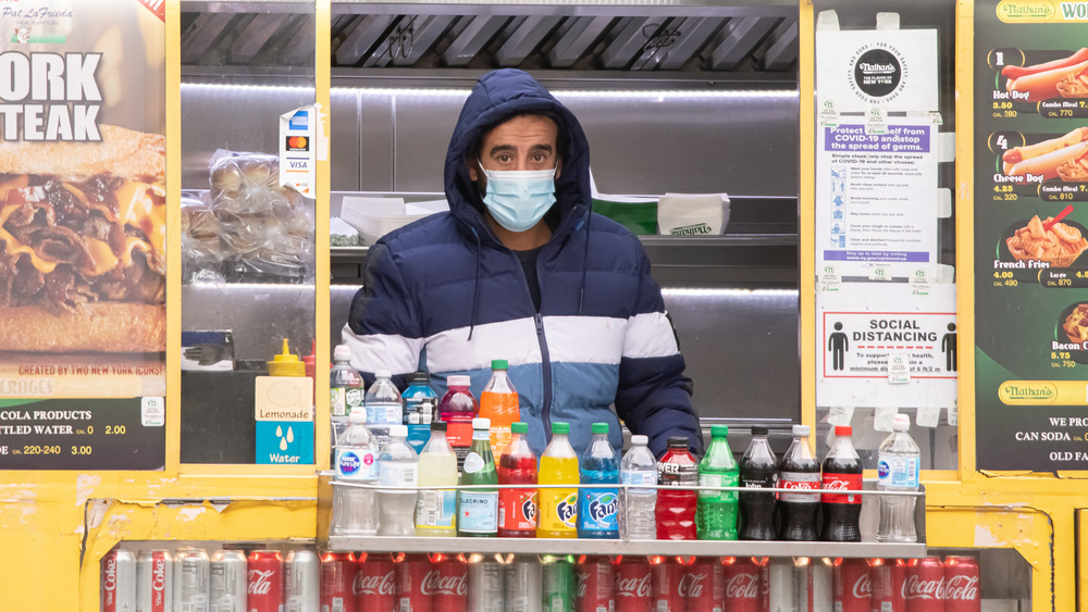 Food truck with masked worker