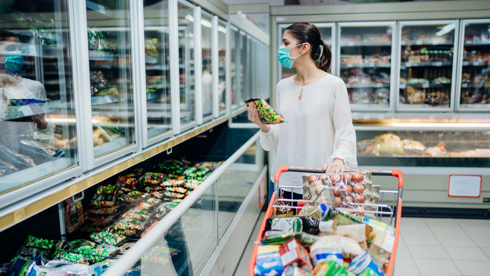 Woman in the supermarket freezer section