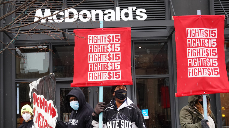 Protesters standing outside McDonald's
