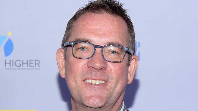 Ted Allen smiling in glasses