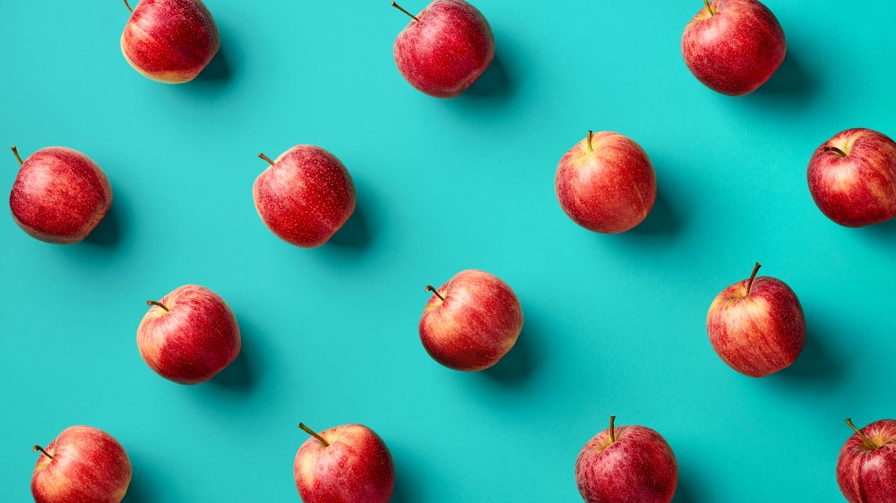 apples against a blue background