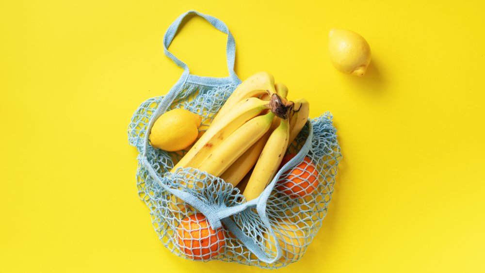 bunch of bananas in a reusable bag