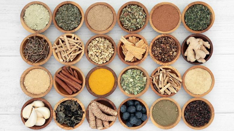 Small bowls of various adaptogenic herbs