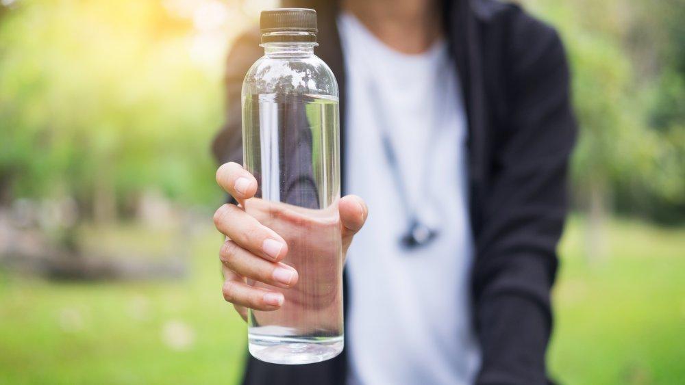 woman-holding-water-bottle