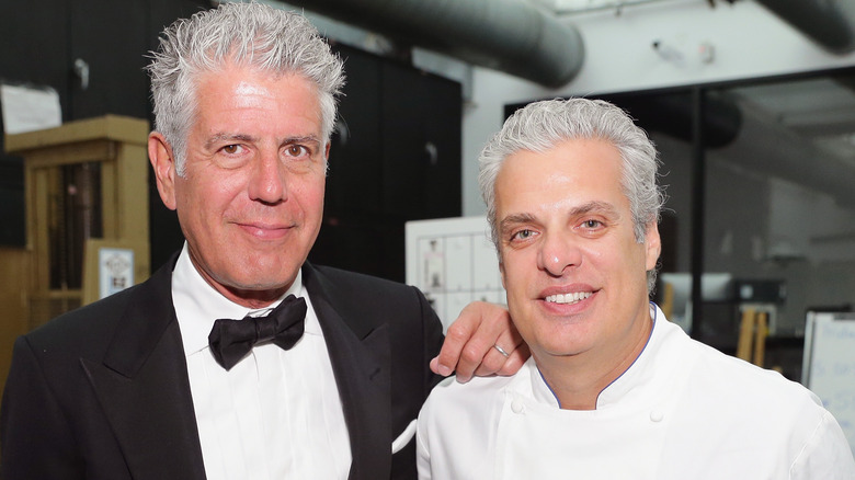 Eric Ripert and Anthony Bourdain smiling at event