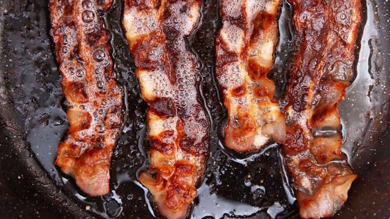 crispy bacon frying
