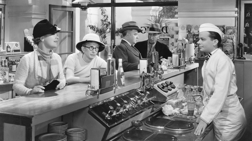 People at soda fountain