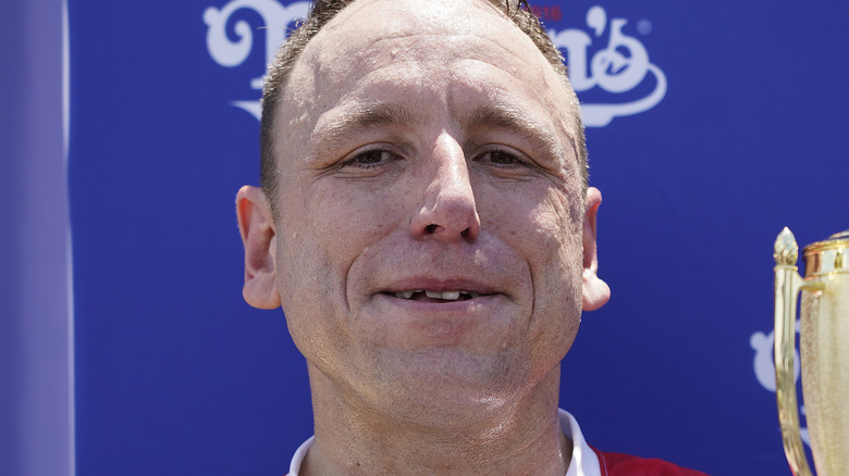 Joey Chestnut smiling and sweating