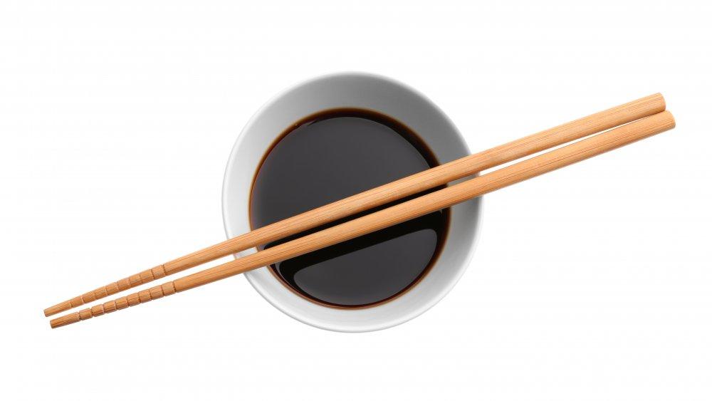 chopsticks on soy sauce bowl