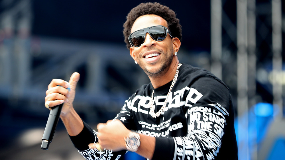 "Chris ""Ludacris"" Bridges holding a microphone"