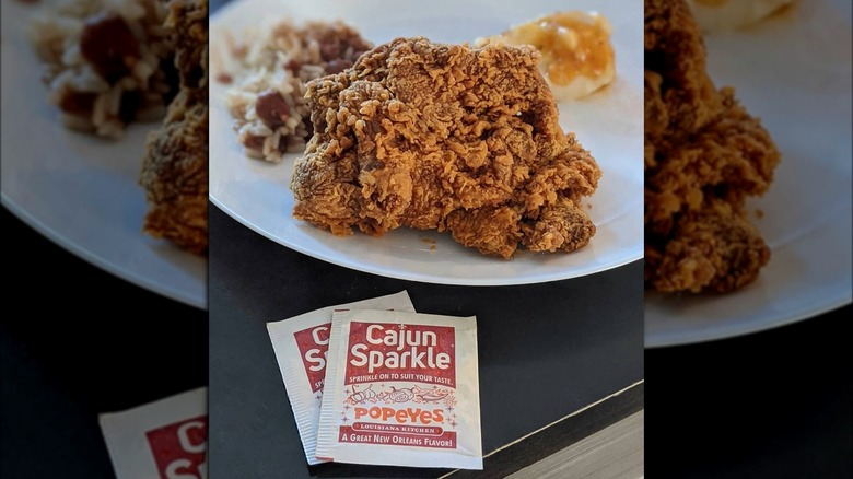 Popeyes chicken and Cajun Sparkle packet