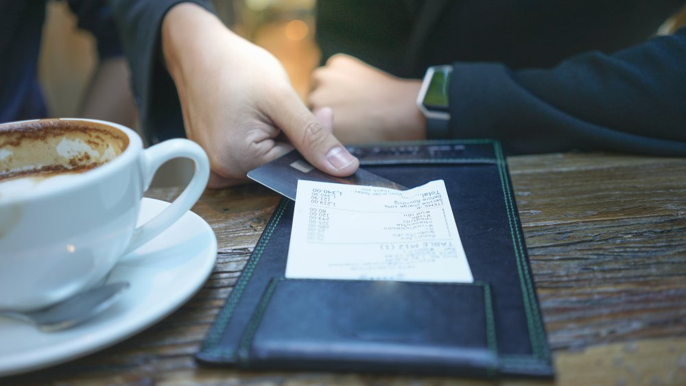 A customer pays his bill at a restaurant