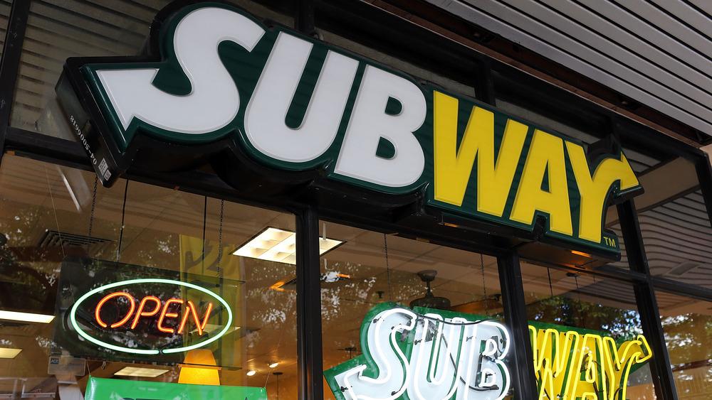 Subway sign lit up