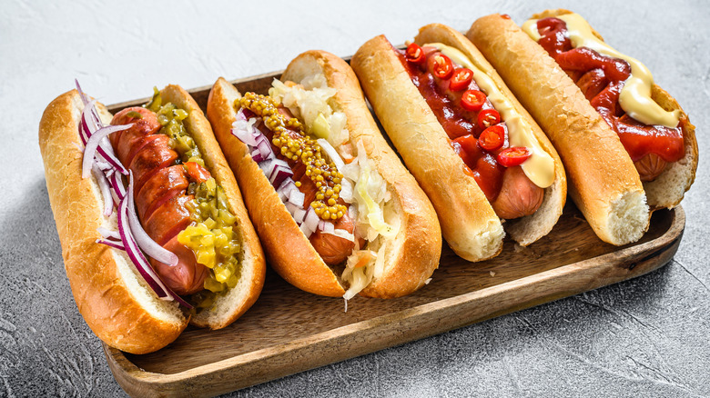 Hot dogs with a variety of toppings.
