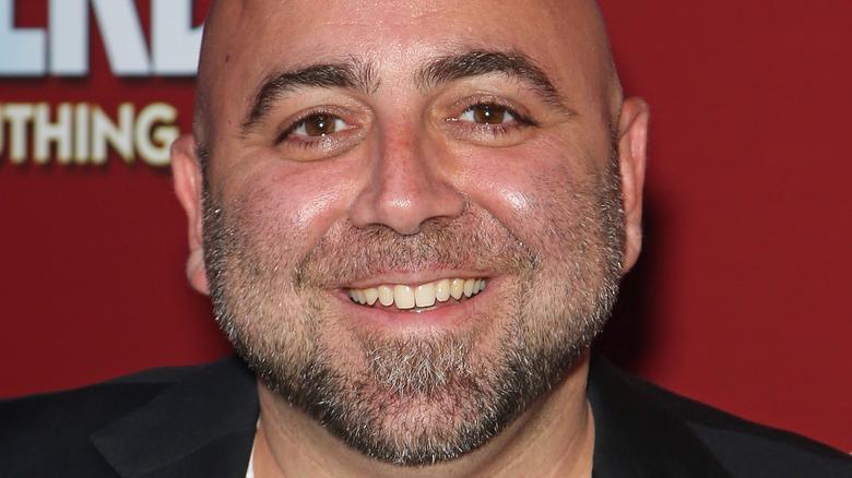 Duff Goldman smiling and wearing blazer