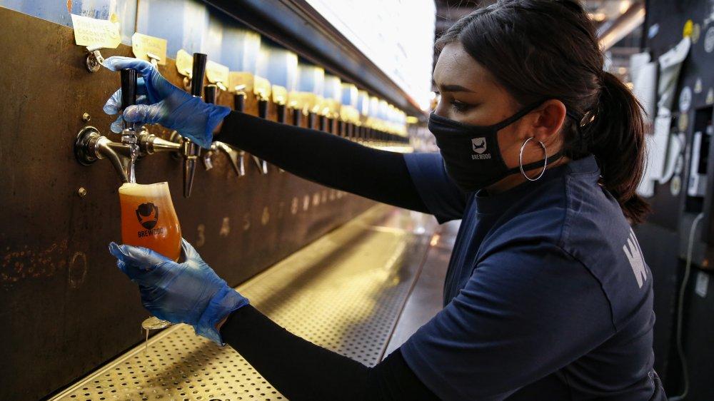 Bartender pouring a beer at a BrewDog pub