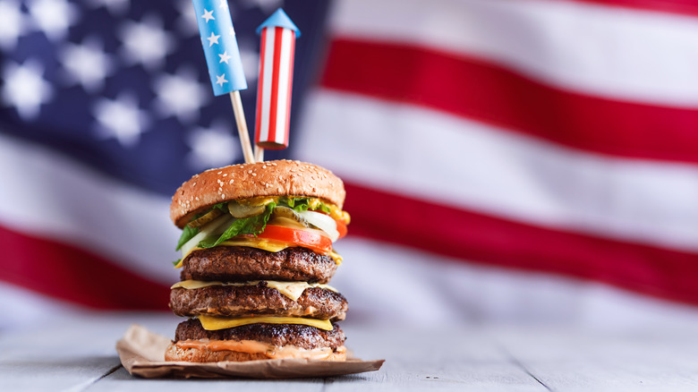 Fireworks-topped triple burger with American flag