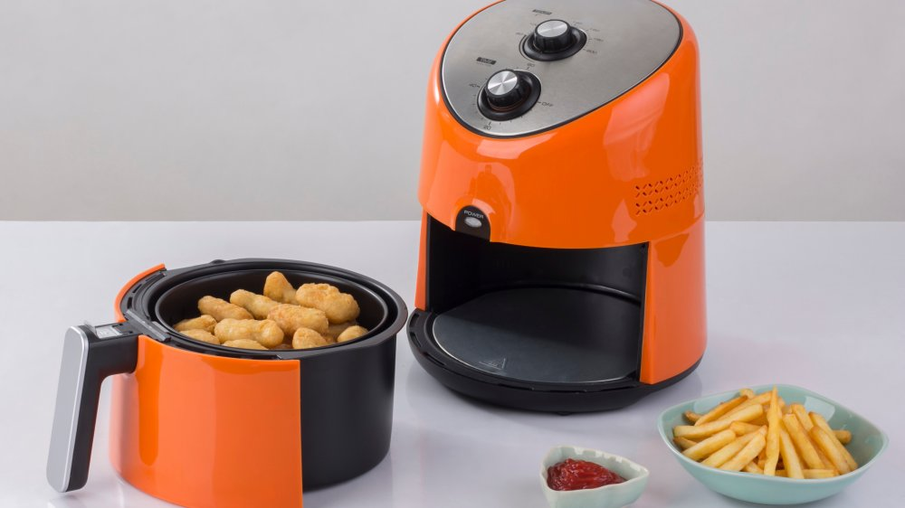 air fryer with chicken and french fries