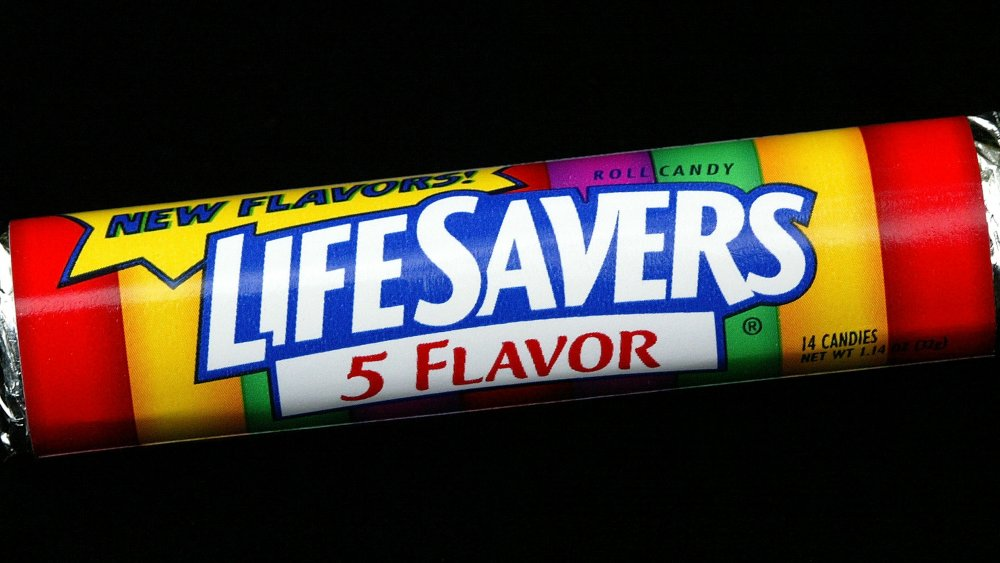 roll of Life Savers on black background