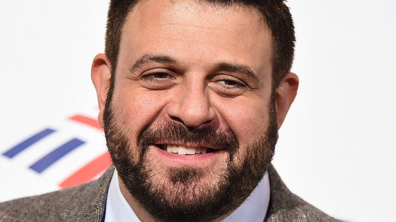 Closeup of Adam Richman in a suit with beard