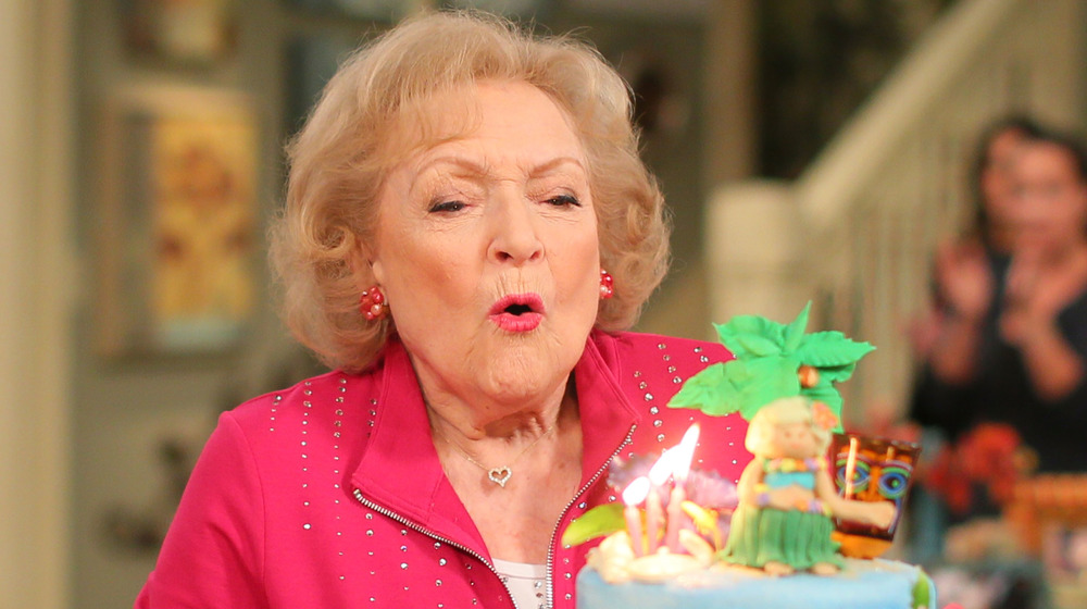 Betty White blowing out candles