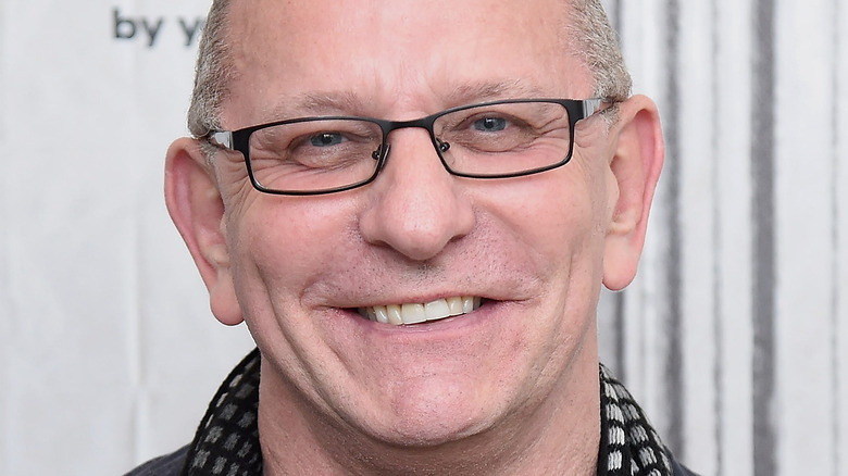 Robert Irvine smiling with glasses