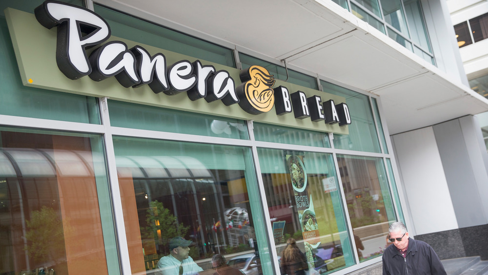 Panera Bread storefront with customers in the window