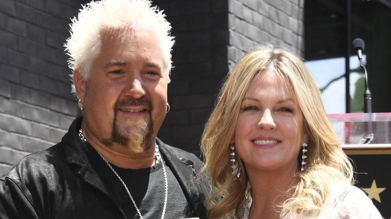 Guy Fieri smiles with wife Lori Fieri