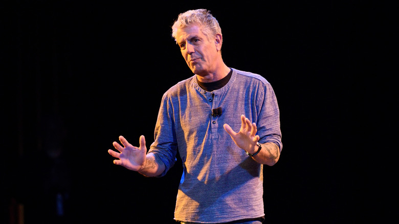Anthony Bourdain with hands up
