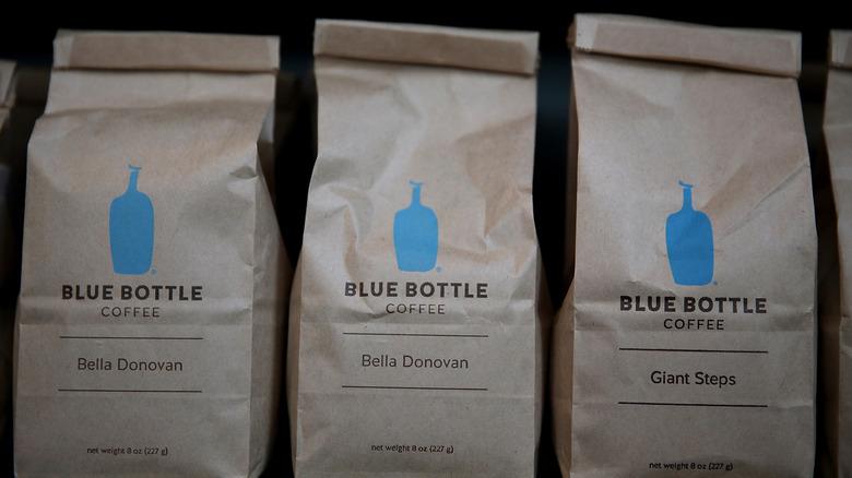 Three brown bags of Blue Bottle Coffee