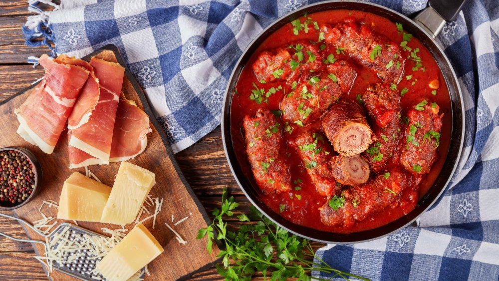 Braciole cooking in tomato sauce