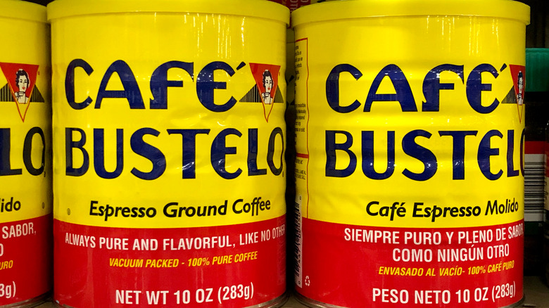 Row of yellow and red Café Bustelo canisters