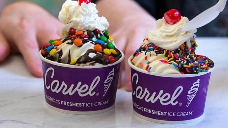 Two paper cups with Carvel logo and ice cream
