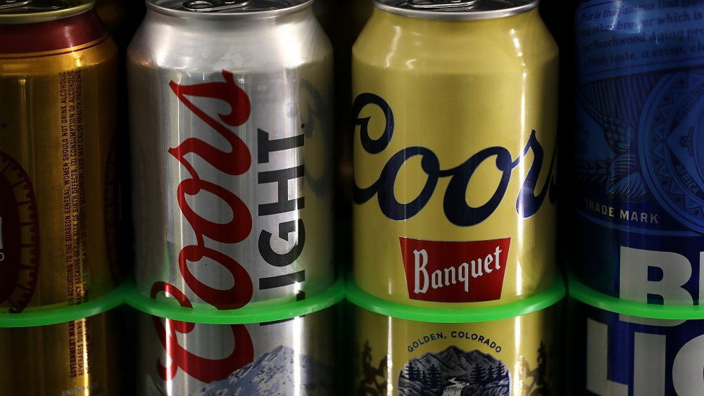 Coors and Coors Light cans on shelf