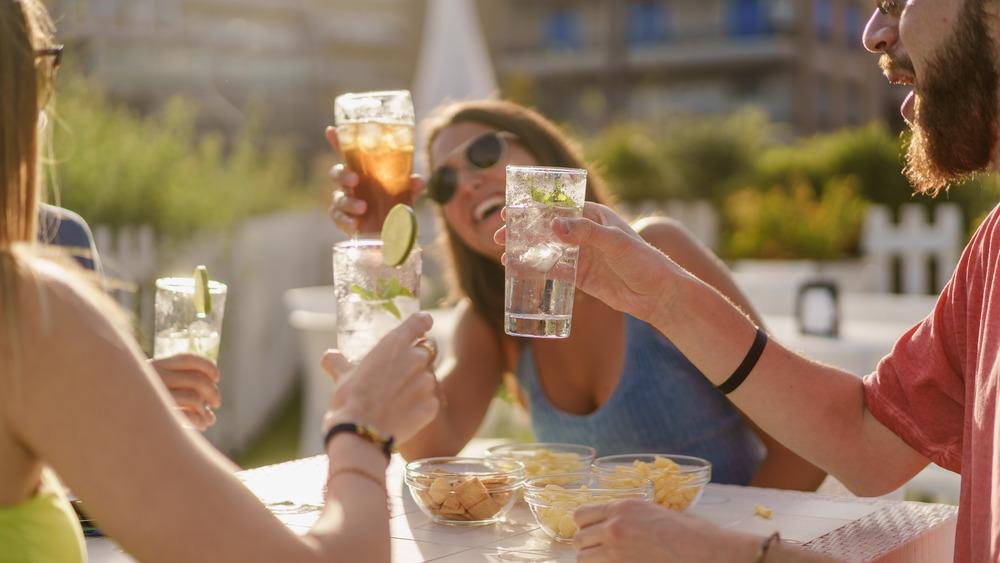 friends raising glasses in toast