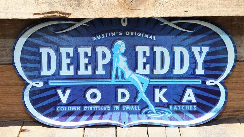 Deep Eddy Vodka sign on wood background