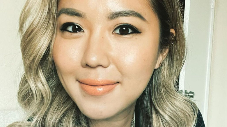 Esther Choi smiling in selfie