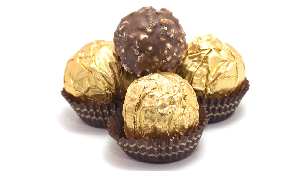 wrapped and unwrapped Ferrero Rocher chocolates
